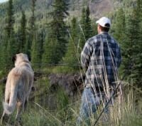 Man and dog in woods