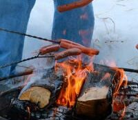 roasting weiners over campfire