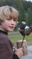 Boy roasting marshmellows