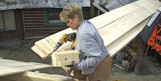 Jill helping to build log cabin