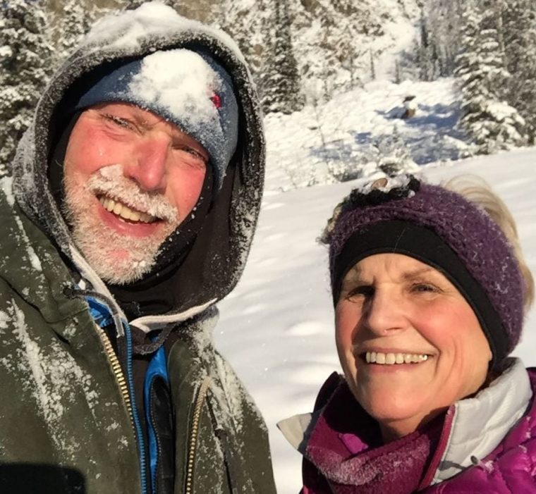 Innkeepers John and Jill in snow, smiling for camera