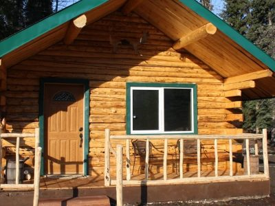 Exterior view of Eagle's Nest cabin with chairs on porch for relaxing