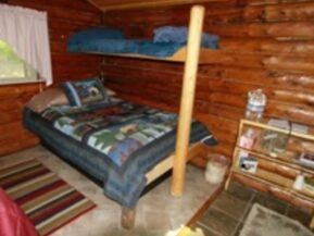 Bed inside of The Duke cabin