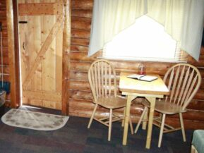 Table and chairs inside of Grub Steak cabin