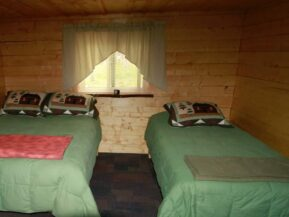 Twin beds in Grub Steak cabin