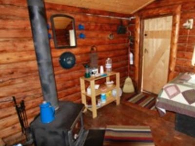 Wood stove and interior of Bear's Den Cabin